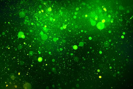 beautiful abstract green bokeh on a black background