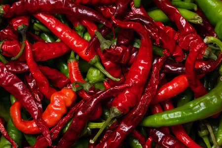 red and green hot chili peppers close up