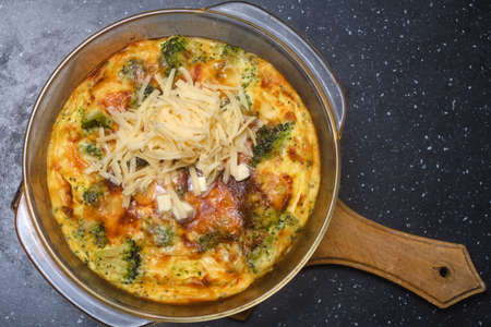 cooked omelet of eggs and broccoli on the table