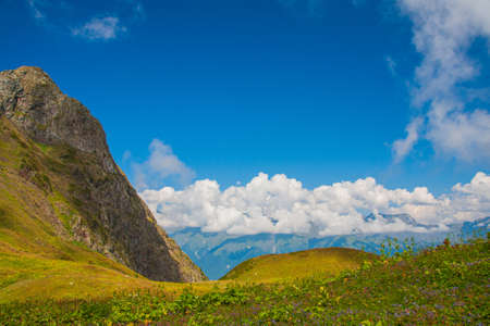 beautiful mountain slope against the background of clouds on a summer day