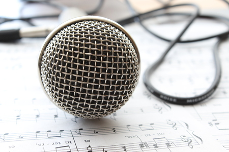Music, silver microphone with cabel. Stock Photo