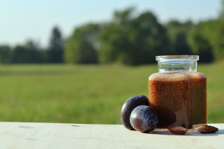 Plums drink with plum and pips in nature.