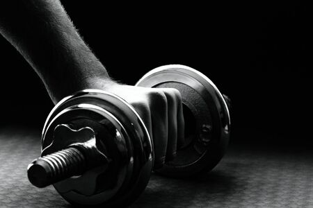 robustness: The human hand rising barbell with pads.