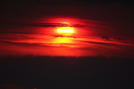 worl: Very red and dark classic sun shine. Change global climate. All the worl global warming.