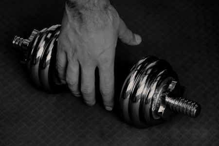 Black and white picture dumbell with hand
