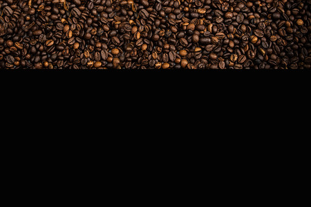 Coffe beans wallpaper with black. Dark coffee beans. Dark coffee arabica for cooking coffee drink. Stock fotó