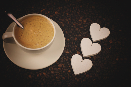 Coffee cup with beans, hearts and shine. Coffee cup for mornig. Coffe drink. Stock fotó