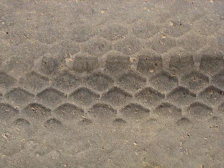 A burned rubber tire track on an asphalt road. photo