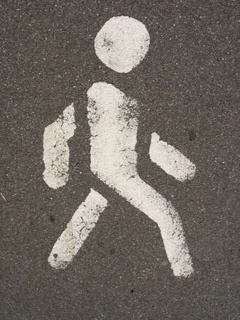 White painted man over black asphalt surface photo