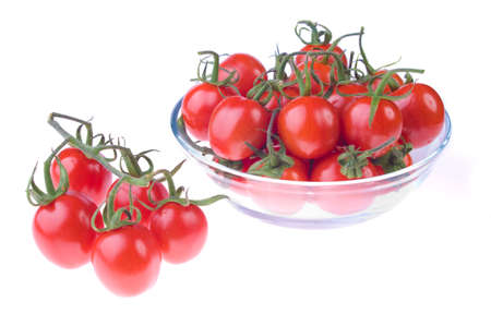Transparent pot with cherry tomatoes on a white background