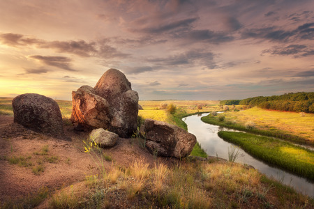 river stones: Beautiful summer sunset at the river with reflection  in Ukraine Stock Photo