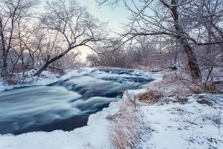 clean water: Beautiful winter sunset at the river Krinka. Forest in Ukraine