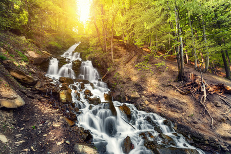 water colour: Beautiful waterfall in spring forest. Sunset  in Ukraine