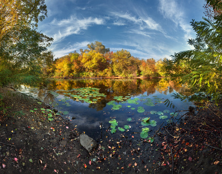 Beautiful autumn sunset at the river in the forest in Ukraine. photo