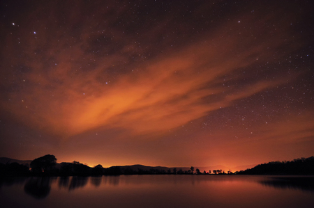 water spring: Beautiful night sky with stars, clouds and reflections in the water. Spring in Crimea Stock Photo