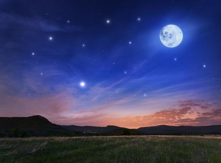 満月と星が美しい夜の空。クリミア半島の春 写真素材