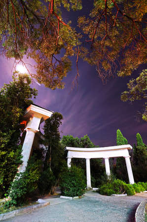 ancient atlantis: Night in the park. Trees behind the columns. Crimea