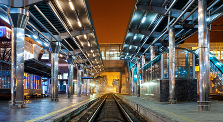 railroad station platform: Railway station at night. Train platform in fog. Railroad