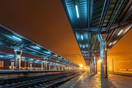 fog: Railway station at night. Train platform in fog. Railroad in Donetsk.