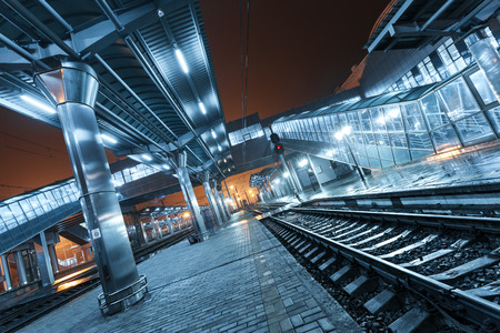 railroad station platform: Railway station at night. Train platform in fog. Railroad in Donetsk.