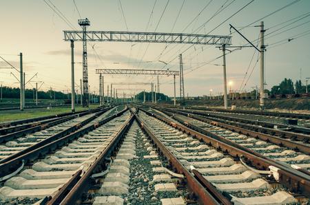 railroad station platform: Cargo train platform at sunset. Railroad in Donetsk. Railway station Stock Photo