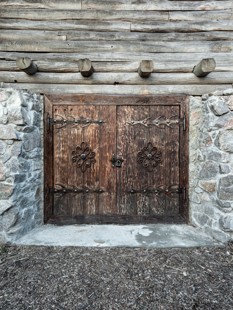 Wooden old door with lock and granite wall. Background for design photo