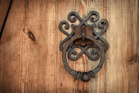 old rusty doorknob and wood door.  Background for design