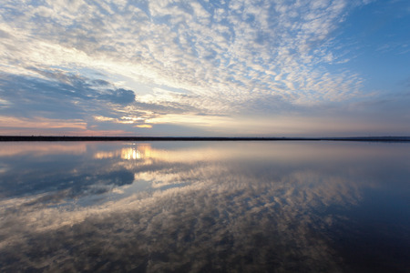 mirror on the water: Landscape with lake reflection clouds. Beautiful summer sunset at the river
