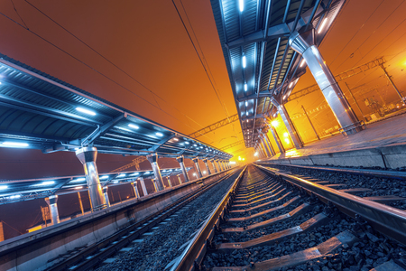 city by night: Railway station at night. Train platform in fog. Railroad in Donetsk Stock Photo