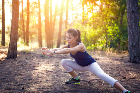pretty lady: Young beautiful girl sports in the autumn forest at sunset