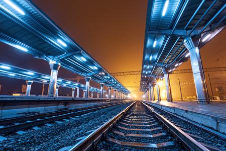 railroad station platform: Railway station at night. Train platform in fog. Railroad in Donetsk Stock Photo
