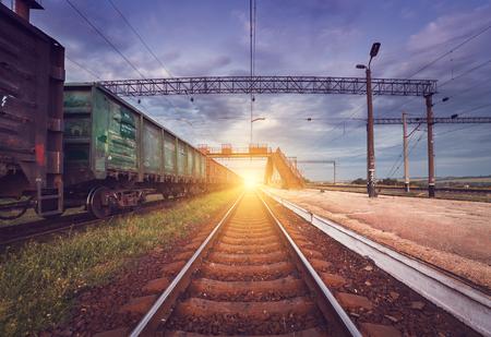 railroad station platform: Cargo train platform at sunset. Railroad in Ukraine. Railway station. Stock Photo