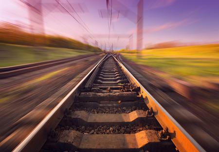 railroad station platform: Cargo train platform at sunset with blur effect. Railroad in Ukraine. Railway station.