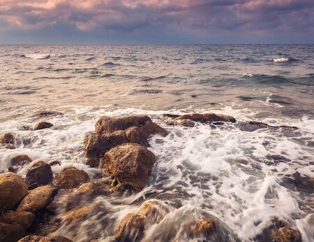 beatuful: Sea waves with rocks on the beach at sunset. Beatuful landscape Stock Photo