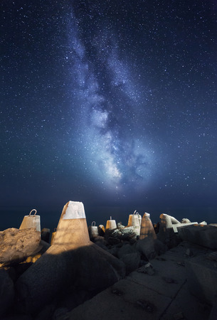 breakwaters: Night landscape with milky way at the sea coast with breakwaters. Starry sky Stock Photo