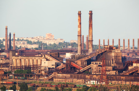 steelworks: Steel factory with smokestacks at sunset. metallurgical plant. steelworks, iron works. Heavy industry in Europe. Air pollution from smokestacks, ecology problems. Industrial landscape