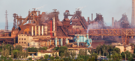 steel works: Rusty steel factory with smokestacks at sunset. metallurgical plant. steelworks, iron works. Heavy industry in Europe. Air pollution from smokestacks, ecology problems. Industrial landscape