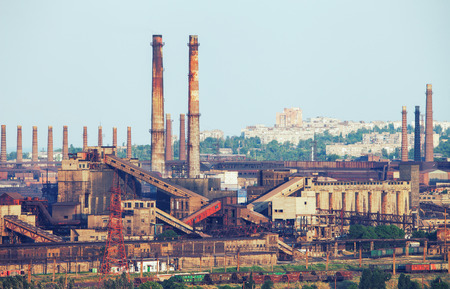 Industrial landscape. Steel factory with pipes at sunset. Metallurgical plant. steelworks, iron works. Heavy industry in Mariupol. Air pollution from smokestacks, ecology problems. Vintage style