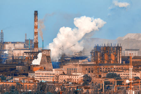 metallurgical: Metallurgical plant. Industrial landscape. Steel factory at sunset. Pipes with smoke. steelworks, iron works. Heavy industry in Europe. Air pollution from smokestacks, ecology problems. Vintage Stock Photo