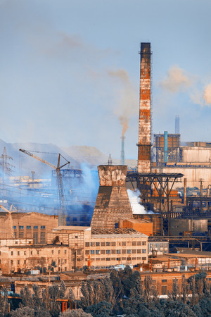 steelworks: Industrial landscape. Steel factory at sunset. Pipes with smoke. Metallurgical plant. steelworks, iron works. Heavy industry in Europe. Air pollution from smokestacks, ecology problems. Vintage style