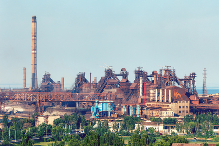steelworks: Industrial landscape. Steel factory with pipes at sunset. Metallurgical plant. steelworks, iron works. Heavy industry in Mariupol. Air pollution from smokestacks, ecology problems. Vintage style