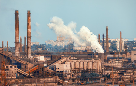 steelworks: Metallurgical plant. Industrial landscape. Steel factory at sunset. Pipes with smoke. steelworks, iron works. Heavy industry in Europe. Air pollution from smokestacks, ecology problems. Vintage Stock Photo
