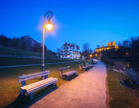 Night landscape with beautiful benches with street lamp at night.