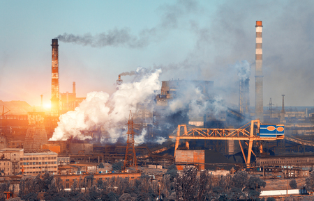 metallurgical: Metallurgy plant in Ukraine at sunset. Steel factory with smog. Pipes with smoke. Steel mill. Heavy industry factory. Metallurgical plant in city. Steel works. Ecology problems, atmospheric pollutants