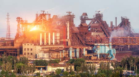 Metallurgical plant at colorful sunset. Industrial landscape. Steel factory in the city. Steel works, iron works. Heavy industry in Ukraine. Air pollution, ecology problems. Industrial buildings