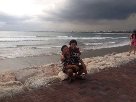 kuta: Old senior couple by the beach, Kuta, Bali, Indonesia Stock Photo
