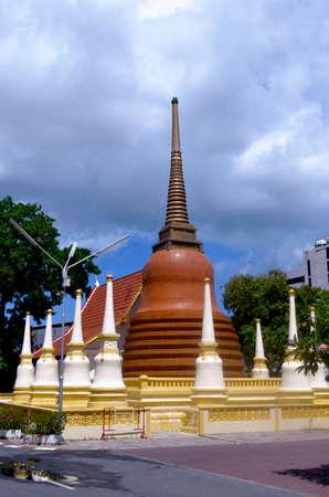 Chedi in the enclosure of Wat Mongkol Nimit in Phuket Town, Thailand