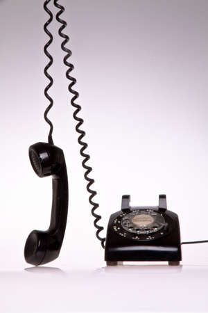 contrasted: old fashion black and scratch 50s phone Editorial