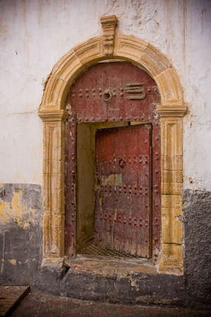 This old half-opened door, seen from a small Casablanca, Morocco street, is an invitation to mystery.