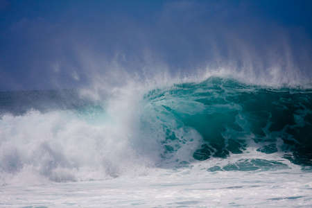 A huge wave is crashing on the beautiful Hawaii Oahus North Shore photo